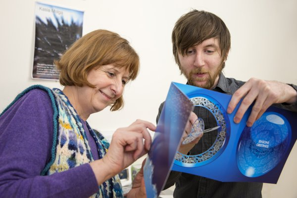 <p>Sallyanne Theodosiou, Senior Lecturer Graphic Design at the University of the Creative Arts in Epsom, and Mike Morris, editor of Packaging Solutions are examining a laser cut card made on Invercote from Iggesund Paperboard.© Iggesund</p>